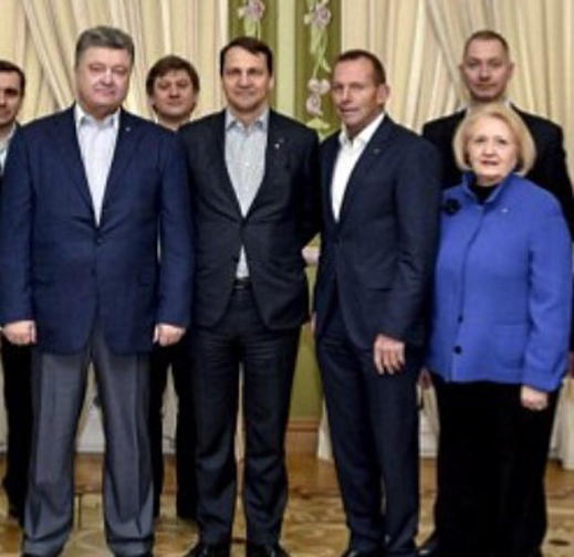 Poroshenko (left) meets in Kiev with his international advisors (centre to right): ex-Polish foreign minister, Radoslaw Sikorski; Abbott; and Melanne Verveer, a Ukrainian-American protégée of Hillary Clinton.