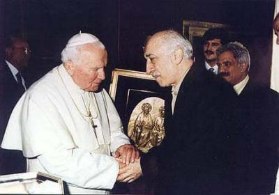 Gülen and the late Pope John Paul II in Rome in 1998, posing as a man of peace and ecumenical harmony.