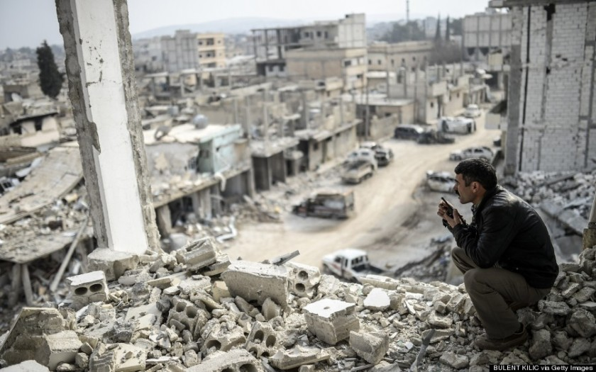 A Kurdish man talks with a radio as he checks the eastern part of the Syrian border town of Kobane, known as Ain al-Arab, on January 28, 2015. Kurdish forces recaptured the strategic town on the Turkish frontier on January 26 in a symbolic blow for the jihadists who have seized swathes of territory in a brutal onslaught across Syria and Iraq.           AFP PHOTO / BULENT KILIC        (Photo credit should read BULENT KILIC/AFP/Getty Images)
