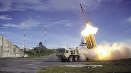 A launch of the THAAD missile defense system in the Asia-Pacific, targeting China.