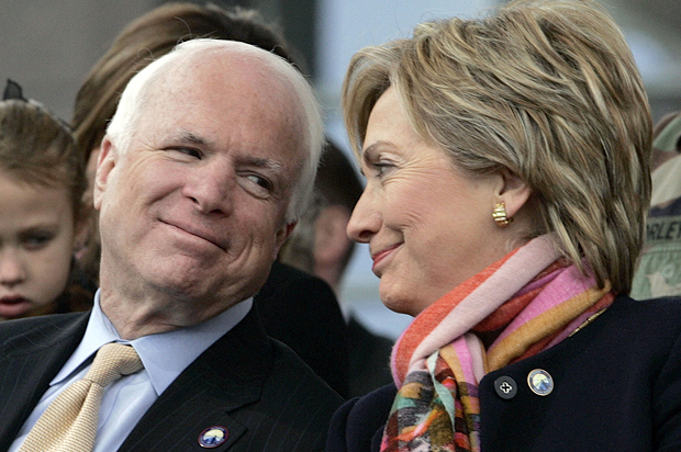 U.S. Senator John McCain (R-AZ), (L), and U.S. Senator Hillary Rodham Clinton (D-NY) look at each other during the opening of The Center for the Intrepid in San Antonio, Texas January 29, 2007. The Center for the Intrepid will provide injured service members with occupational and physical therapy to help with their rehabilitation. REUTERS/Jessica Rinaldi (UNITED STATES) - RTR1LRXI